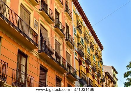 Colorful Traditional Houses Of The 19th Century On Torre Nueva Street In Saragossa, Spain