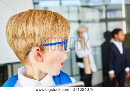 Amazed boy with open mouth as a student or trainee in a meeting