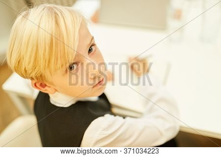Boy as a trainee in the business office or as a student in class while learning