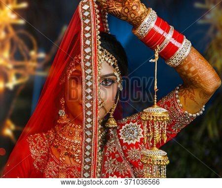 Mumbai, India - 20 April 2019 : Indian Women In Red And Gold Sari Dress.