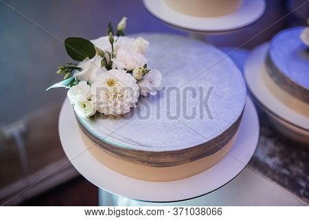 Cake Custom With Flower Items On The Table