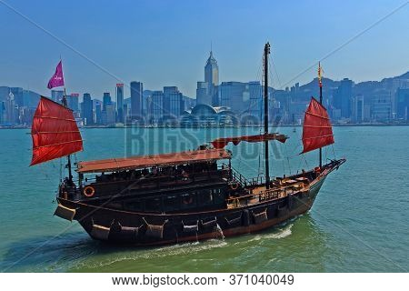 Hong Kong, China - 4 October 2018: Traditional Chinese Wooden Sailing Ship With Red Sails Down In Vi