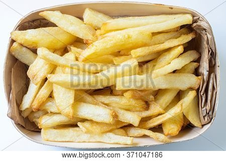 Homemade Deep Fried French Fries On Wooden Basket