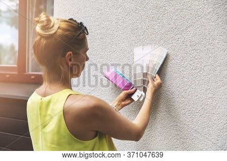 Designer Choosing Paint Color For House Exterior Stucco Facade