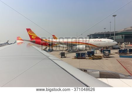 Hong Kong, China - October 7, 2018: View From Airplane Porthole On Plane Of Hongkong Airlines Parked