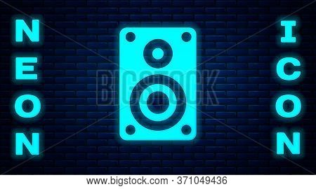 Glowing Neon Stereo Speaker Icon Isolated On Brick Wall Background. Sound System Speakers. Music Ico
