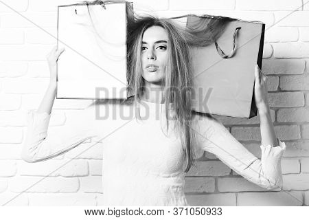 Pretty Girl With Colorful Pegs On Brick Wall Studio Background