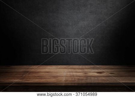 Old Wooden Table Top And Black Wall With Lighting  On The Dark Background 3d Illustration