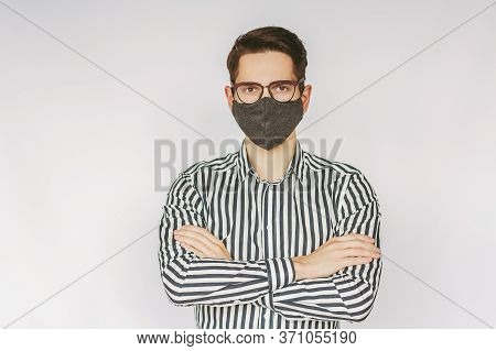Portrait Young Successful Businessman In Protective Face Mask, Eyeglasses Keep Arms Crossed Isolated
