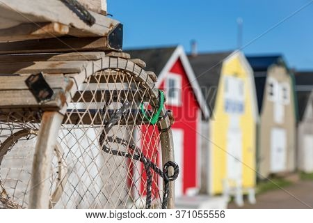 Lobster barns and lobster pots of New London, Prince Edward Island, Canada. Horizontal format.
