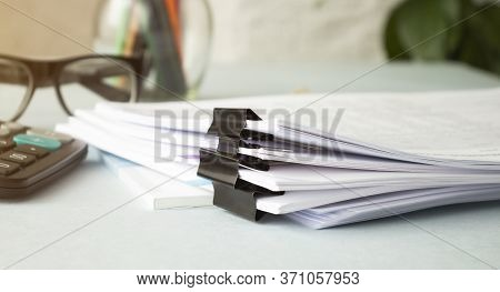 Hands Of Businessman Hold Pen For Work In Stacks Of Paper Files, Information Search For Business Rep