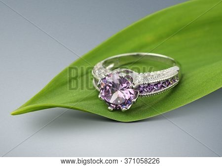 Jewelry Ring With Big Tourmaline On Green Leafs Background