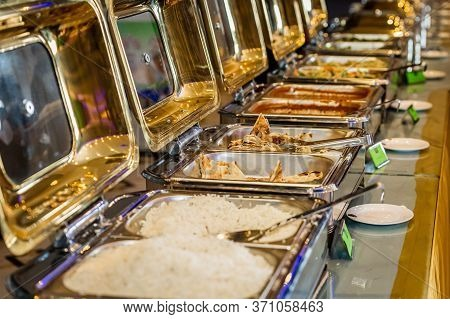Banquet Catering Food On Chafing Dishes.banquet Buffet Food At Indian Weddings Event.selective Focus