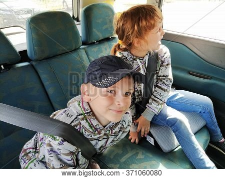 Belgrade, Serbia. 06 June 2020. Children In The Car. A Boy And A Girl Are Sitting In The Back Seat,