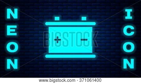 Glowing Neon Car Battery Icon Isolated On Brick Wall Background. Accumulator Battery Energy Power An