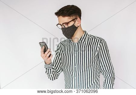 Portrait Busy Young Businessman In Protective Face Mask And Eyeglasses Use Mobile Phone Isolated On