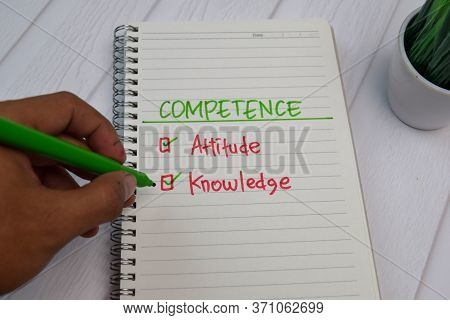 Competence Write On A Book. Supported By An Additional Services Isolated Wooden Table.