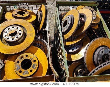 Old Rusted Car Brake Discs In The Junkyard