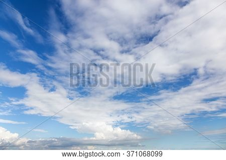 View Of Puffy White Clouds With Blue Sky During A Beautiful Sunny Day. Taken Over Vancouver, British