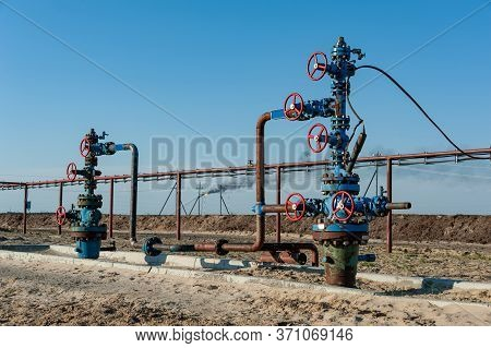 Petroleum Well Wellhead Equipment. Hand Valve With Handwheel On The Flow Line. Oilfield Site. Oil, G