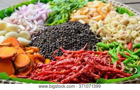 Top View Of Various Spices And Herbs. Turmeric, Ginger, Bergamot, Paprika, Dried Peppers, Garlic, Le