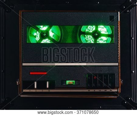 reel to reel audio tape recorder with green led light strip. VU meter with