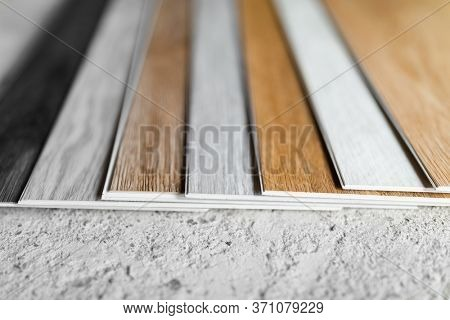 laminate flooring planks variations on concrete floor