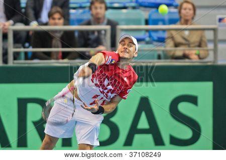 WIENER NEUSTADT, AUSTRIA - FEBRUARY 10 Andreas Haider-Maurer (Austria) beats Alex Bogomolov (Russia) in a four set match during the Davis Cup event on February 10, 2012 in Wiener Neustadt, Austria.