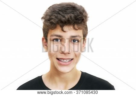 Cute Boy On A White Background. On His Teeth, After Visiting The Orthodontist, There Are Braces. Iso
