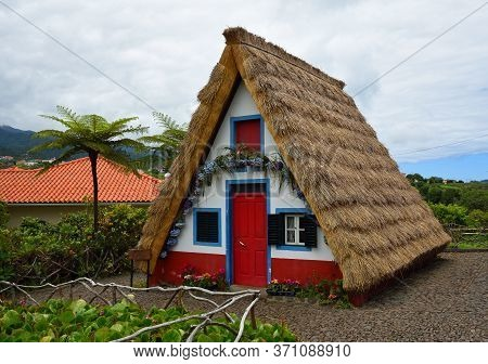 Santana, Madeira, Portugal - June 25, 2019: Traditional Madeira Building With Thatched Roof.