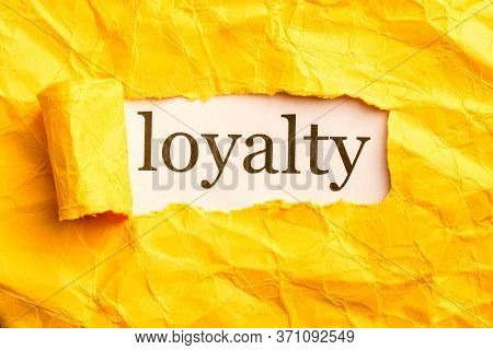 In A Paper Window The Inscription Loyalty. Discover Loyalty In Yourself