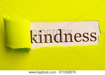In A Torn Window The Inscription Kindness. Light Green Background With Torn Space
