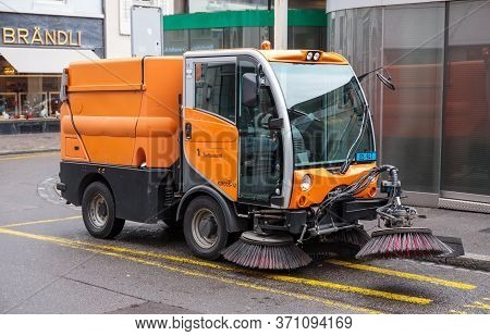 Basel, Switzerland - March 31, 2018: Street Cleaning Vehicle On A Street In Basel