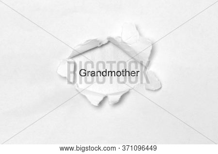 Word Grandmother On White Isolated Background, The Inscription Through The Wound Hole In Paper. Stoc