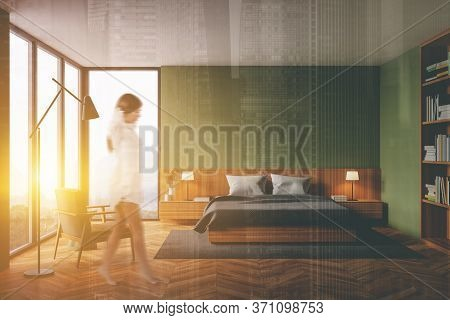 Blurry Young Woman Walking In Luxury Panoramic Bedroom With Green Walls, Wooden Floor, Comfortable K