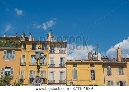 The Tops Of A Group Of Buildings In Aix-en-provence.