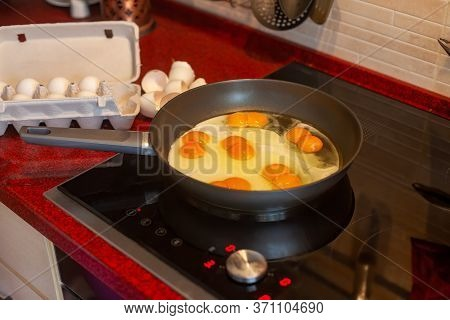 Double Yolk, Strange Two Yolks In One Hen Lucky Egg Frying Sunny-side Up In A Cast Iron Pan On The S
