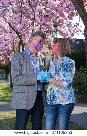 Loving Couple In Face Masks And Gloves.