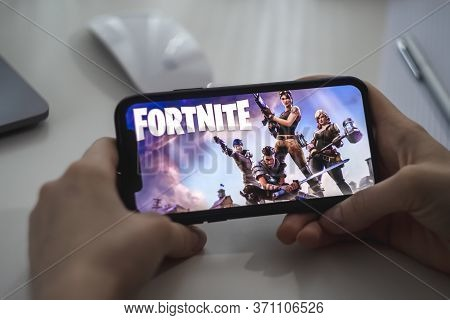 Fortnite Game On The Iphone Screen. High Quality Photo