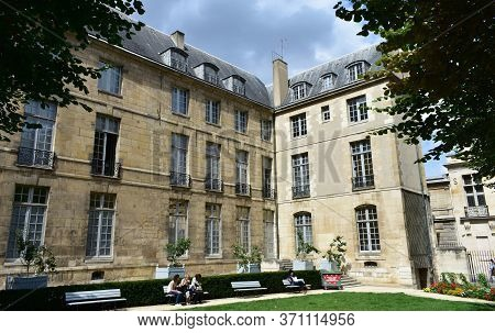 Paris, France. August 14, 2019. Garden In Parisian Style Mansion Known As Hotel Particulier. Hotel D