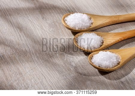 Magnesium Chloride In Three Wooden Spoons - Text Space