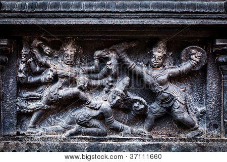 Bas relief depicting Durga slaying demon (Maheeshasuramardini). Brihadishwara Temple. Tanjore (Thanjavur), Tamil Nadu, India. The Greatest of Great Living Chola Temples - UNESCO World Heritage Site poster
