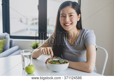 Eat Healthy Food On Wellness Lifestyle. Beauty Young Woman Eating Salad As A Breakfast.