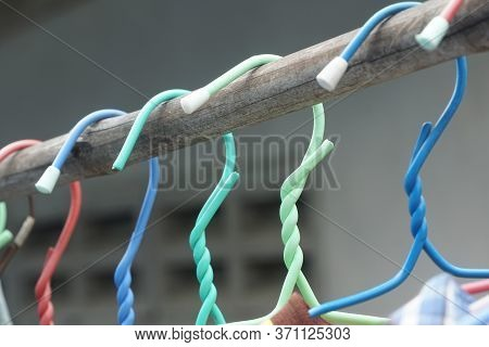 Close Up Colorful Hangers On Bamboo Pole