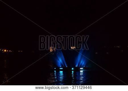 Illuminated Fountain On The Dnieper River In Dnipro City, Ukraine