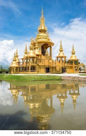 Reflection View Of Golden Ganesha Shrine (ganesha Exhibition) In Wat Rong Khun An Iconic Tourist Att