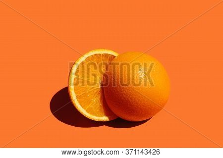 Orange Fruit. Round Orang Slice Isolate On Colorful Background.