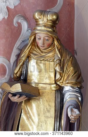 ZAGREB, CROATIA - MAY 16, 2013: Saint Bridget of Sweden statue on the altar of Saint Apollonia in the Church of Saint Catherine of Alexandria in Zagreb, Croatia