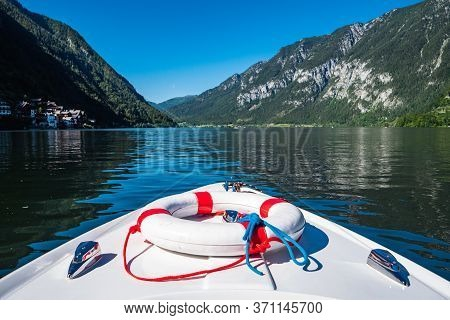 Boating On Lake Hallstatt With An Electric Motor Boat In A Beautiful Alpine Landscape, The Prow Or B