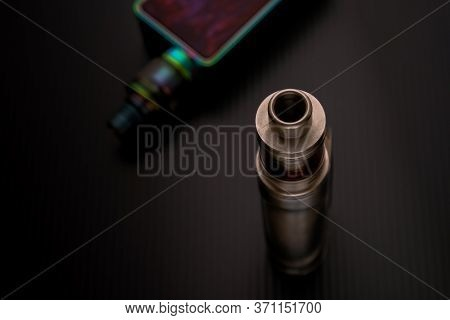 Conceptual Of Recent Uncertainty Of Health Safety Of E-cigarette. Isolated Close-up Of Atomizer Atta